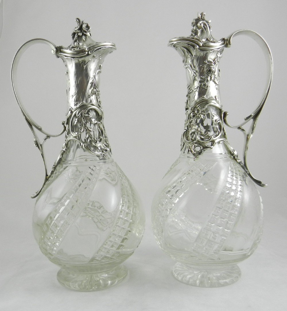 pair antique silver mounted claret jugs